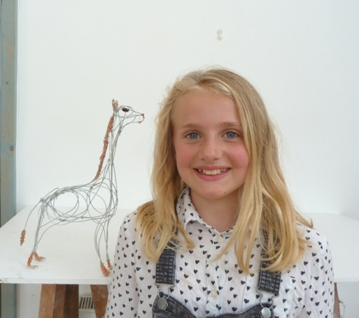 Young artist with wire sculpture