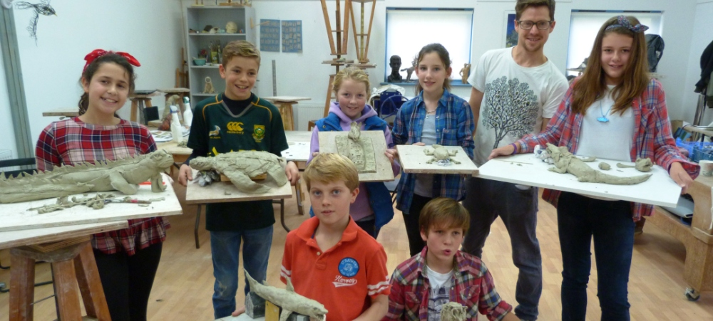 Young artists with their clay animals
